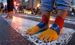 Student protesters march barefoot in Caracas