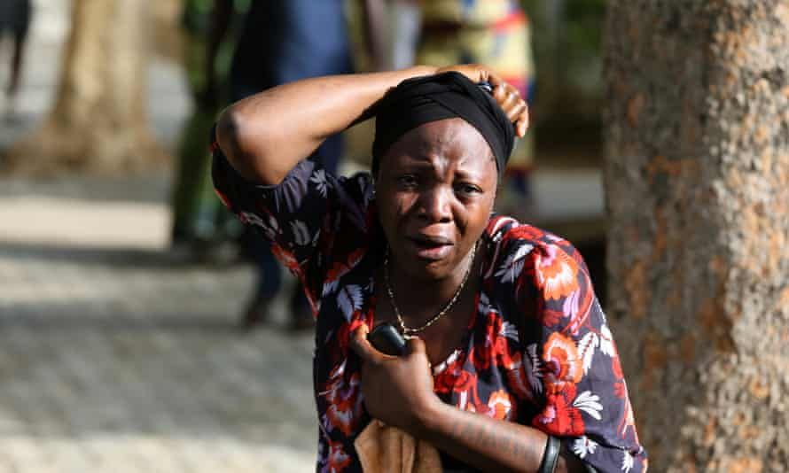 A bystander reacts as victims of a bomb blast arrive at the Asokoro General Hospital in Abuja on 14 April, 2014.