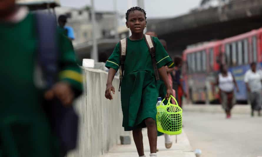 A girl walks to school in Lagos, Nigeria.