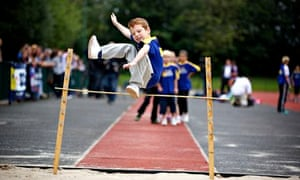 boy doing high jump