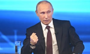 Vladimir Putin gestures while speaking during his annual call-in live broadcast in Moscow