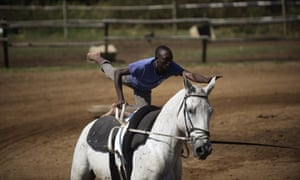 Musa Mugulega practices tricks at a lesson at the Soweto Equestrian Centre.