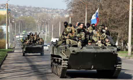 Men wearing military fatigues in the eastern Ukrainian city of Kramatorsk