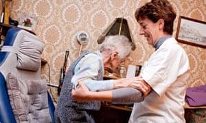 Nurse helps elderly woman