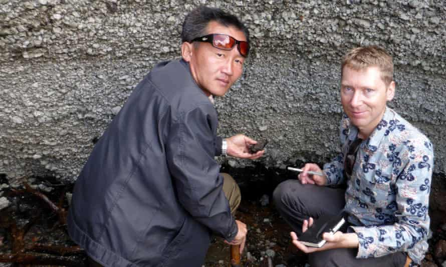 Clive Oppenheimer and Kim Ju Song investigating an outcrop of the Millennium Eruption Deposit at Mount Paektu, North Korea Photograph: Clive Oppenheimer