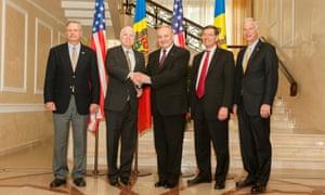 John McCain (2-L), senior Republican US senator from Arizona, shakes hands with the President of Moldova Nicolae Timofti (C) during a visit of US senators in Chisinau, Moldova, 17 April 2014. McCain was accompanied by John Hoeven, R-ND (L), John Barrasso, R-WY (2-R) and Ron Johnson, R-WI (R).