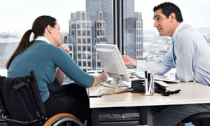 A disabled person in an office