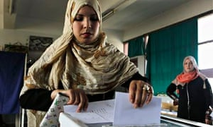 A woman casts her ballot during presidential election in Algiers