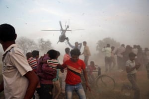 Electioneering in style: A helicopter carrying Nagma, Bollywood actress and Congress party candidate for Meerut, takes off after attending an election rally near Allahabad, India. Indians cast their ballots on the biggest day of voting in the country's week long general election.