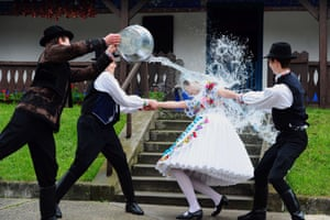 Hungarian children celebrate Easter with a traditional fertility ritual which involves watering the girls. In Kalocsa, some 100 km south of Budapest the boys take on their roles as waterers with gusto.