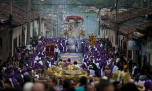 Members of the El Nazareno brotherhood participate in the procession of Jesus of Nazareth in the indigenous town of Izalco, El Salvador.