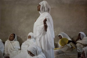 Ethiopian Orthodox Christian women pray at Deir El Sultan during the Washing of the Feet ceremony outside the Church of the Holy Sepulchre, traditionally believed by many to be the site of the crucifixion and burial of Jesus Christ, in Jerusalem.