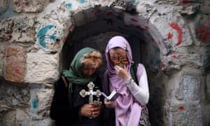 Orthodox Christian worshippers hold crosses during a Good Friday procession on the Via Dolorosa, retracing what many believe to be the route Jesus Christ took before his crucifixion, in the Old City of Jerusalem.