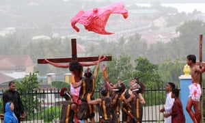 Indonesians perform the tenth station 'Jesus is stripped of his garments' during a re-enactment of the Stations Of The Cross on Good Friday at the Raja Agung church in Bintan Island.