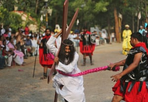 An Indian Christian devotee enacts the crucifixion to mark Good Friday at The Mount Carmel Church in Hyderabad, India.