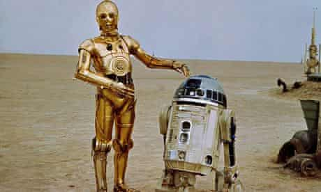 C-3PO and R2-D2 in the desert in the original Star Wars film released in 1977