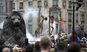 Actors of the Wintershall Players perform The Passion of Jesus on Good Friday to crowds in Trafalgar Square in London