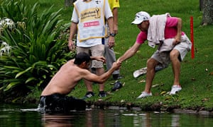 Pablo Larrazabal of Spain is pulled out of a lake after being attacked by a swarm of hornets