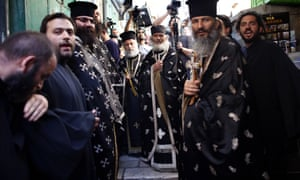 Greek Orthodox priests take part in the Good Friday procession along the Via Dolorosa in Jerusalem.