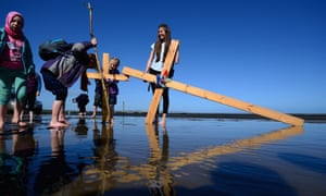 The Northern Cross pilgrimage undertakes its final leg of the journey to Holy Island in Berwick-upon-Tweed, UK crossing the tidal causeway during the annual Christian pilgrimage.