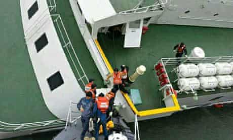 An image said to show captain  Lee Joon-seok being helped off the stricken ferry the Sewol.