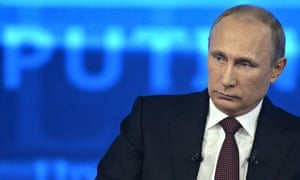 Russian President Vladimir Putin takes part in a live broadcast nationwide phone-in in Moscow