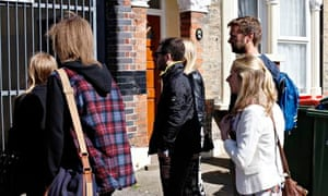 Buyers gather yesterday outside a flat in Forest Gate, east London.