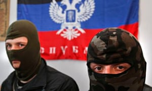 Masked activists with a banner reading 'Donetsk Republic'