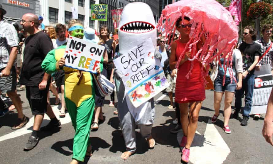Protesters, some in costume, march along George Street in Sydney during a demonstration to save the Great Barrier Reef.