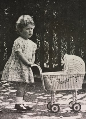 The two-year-old Princess Elizabeth with her wicker pram in the grounds of her home in Piccadilly, London, 1928