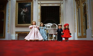 Dolls and a pram belonging to Queen Elizabeth II are displayed at Buckingham Palace