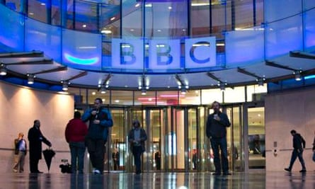 People arrive at, and leave, the BBC headquarters at New Broadcasting House in central London