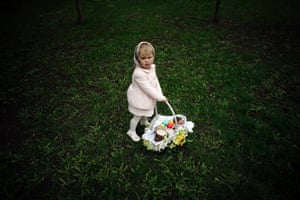 A girl holds a basket with Easter eggs in the park in Donetsk, Ukraine