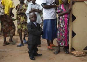 A boy in a suit arrives for Easter Sunday celebrations at the Saint Joseph Cathedral in Bambari, Central African Republic.