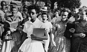 Black students are escorted into Little Rock High School, Arkansas