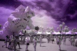 Becoming Human, an art installation by Christian Ristow, looms over crowds at the Empire Polo Club in Indio, California