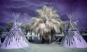 Teepees stand next to Lake El Dorado