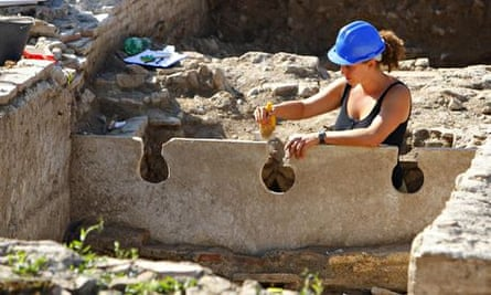 An archaeologist works at Portus