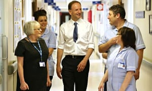 Simon Stevens (centre), chief executive of NHS England