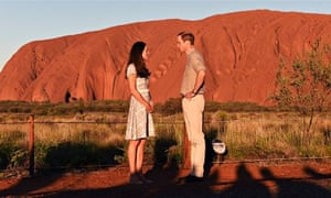 Catherine, Duchess of Cambridge and Prince William pose in front of Uluru