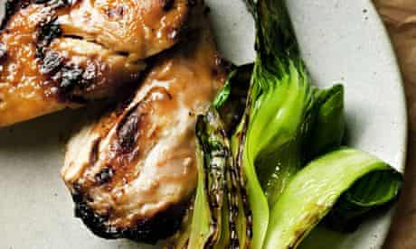 Grilled miso chicken on a round plate with pak choi