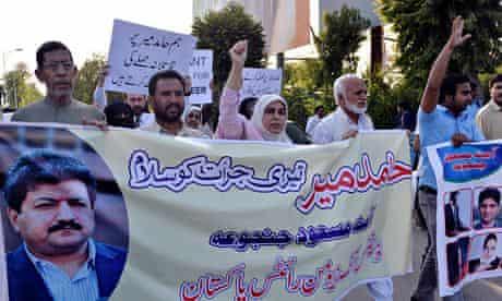 Activists shout slogans Hamid Mir