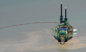 A  dredge operates in the Gladstone Harbour, Queensland.