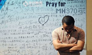 A billboard in Beijing contains tributes to the missing passengers of flight MH370