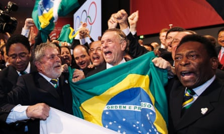 Pele (right) joins Brazil's president at the time, Luiz Inacio Lula da Silva (left) and Olympic campaign president Carlos Nuzman (centre) to celebrate Rio being awarded the Games.