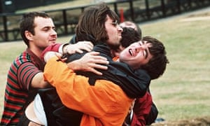Fraternal greetings from Liam and Noel Gallagher at Knebworth in August 1996