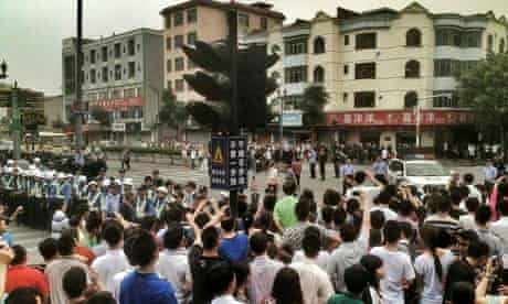Striking workers protest near the Yue Yuen shoe factory complex in Dongguan
