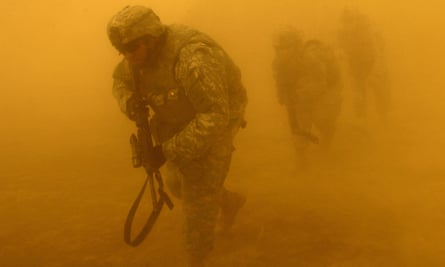 US Army Soldiers exit a UH-60 Black Hawk helicopter during a mission near Tall Afar, Iraq July 2, 2006.