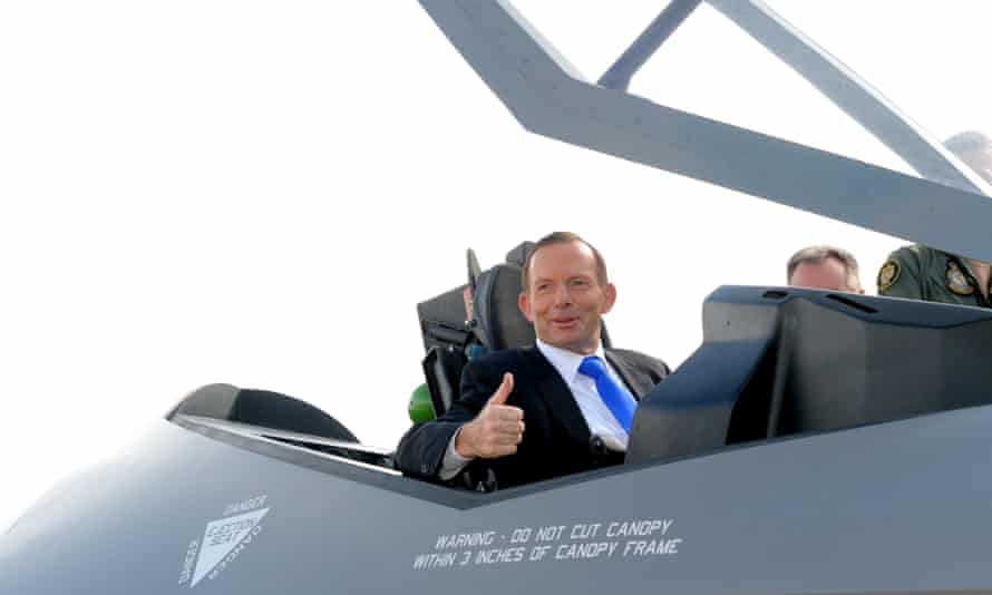 Prime minister Tony Abbott tries out the cockpit of the F-35 fighter plane in Canberra.