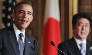 Barack Obama, pictured with Shinzo Abe, has said Japan is in charge of the Senkaku islands and they are covered by a defence treaty between the US and Japan